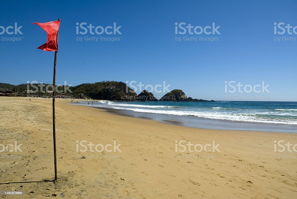 Warning red flag for the vigour of  water in ocean royalty-free stock photo