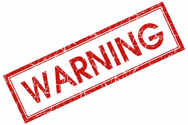 warning red stamp stock photo