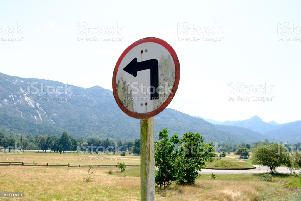 Warning road sign in Thailand ,Turn left,Traffic signs symbols stock photo