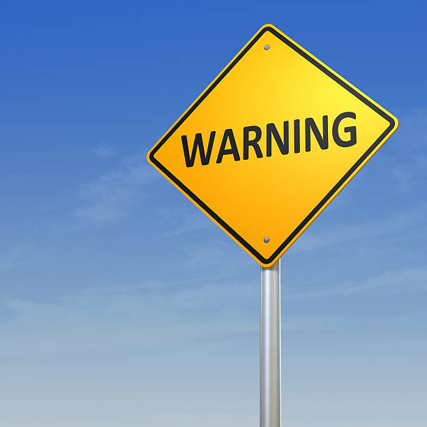 Warning Road Sign stock photo