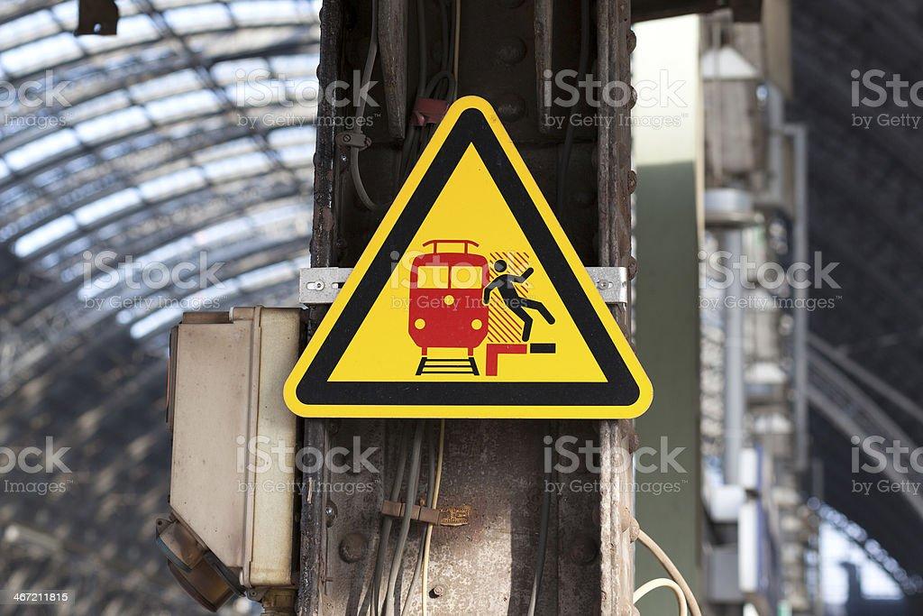 Warning sign at railroad station platform