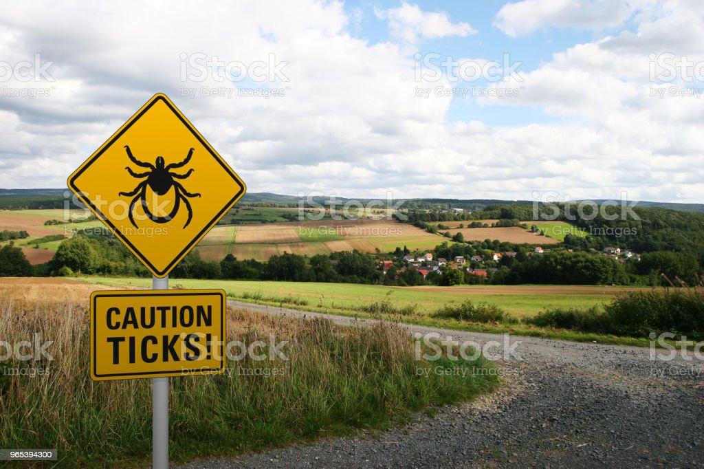Warning sign 'Caution ticks' royalty-free stock photo