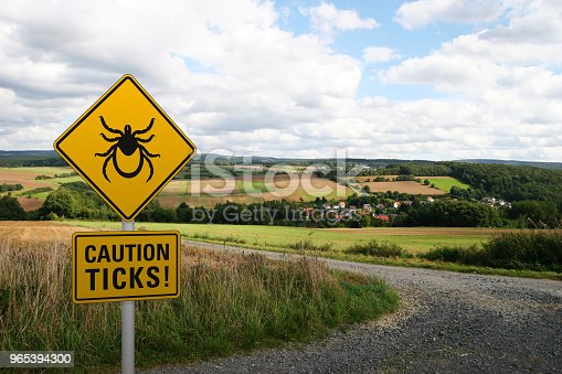 Warning Sign Caution Ticks Stock Photo & More Pictures of Advice