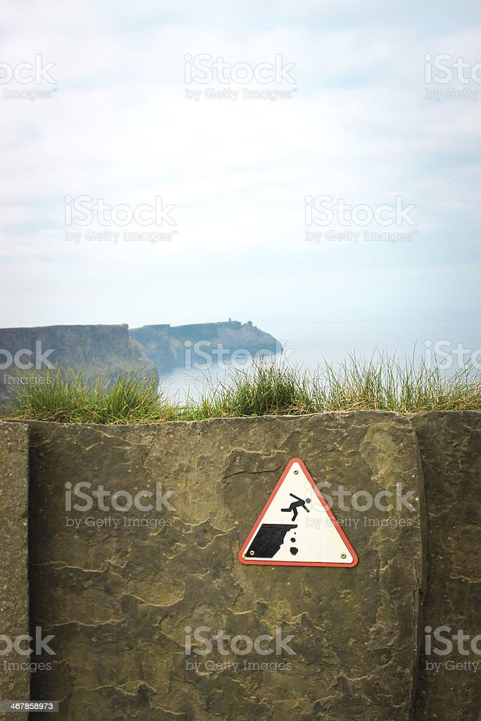 Warning sign Cliffs of Moher, Ireland stock photo