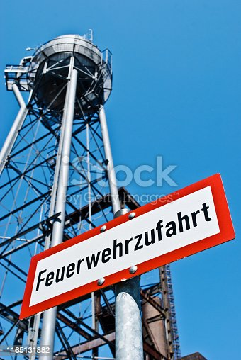 Warning sign: Fire Engine Access (Feuerwehrzufahrt in German language) outside an decommissioned factory