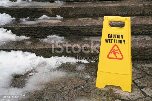 istock Warning sign for wet floor 937415992