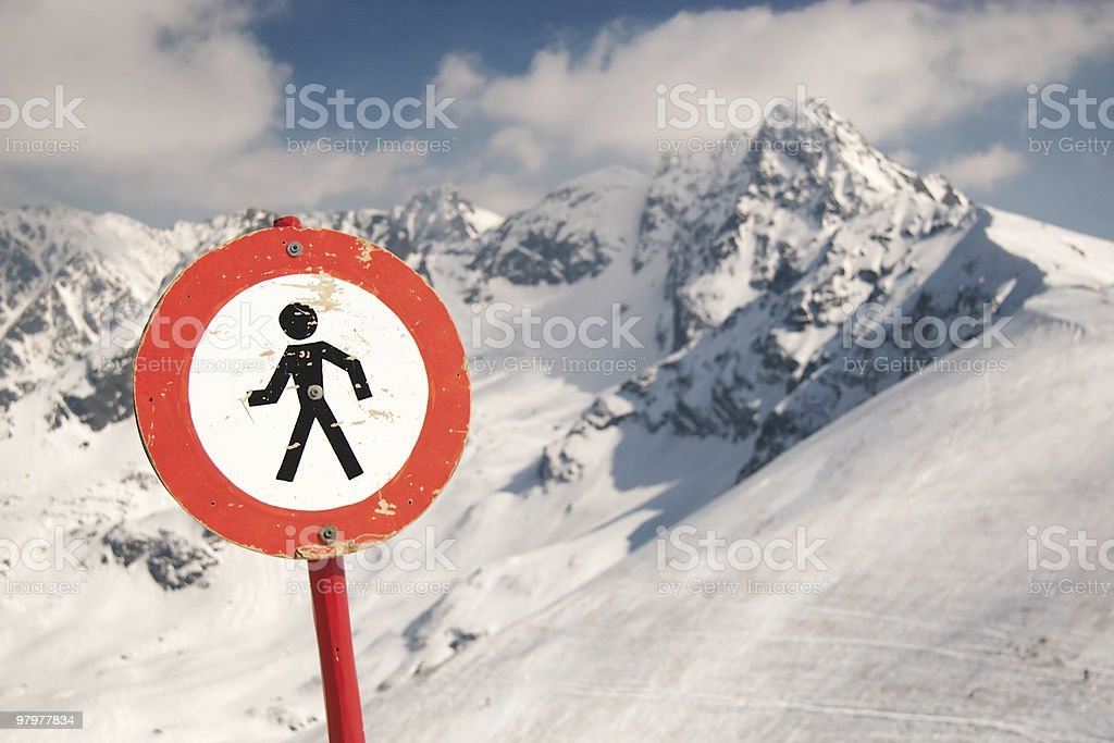 Warning sign in snowy mountains royalty-free stock photo