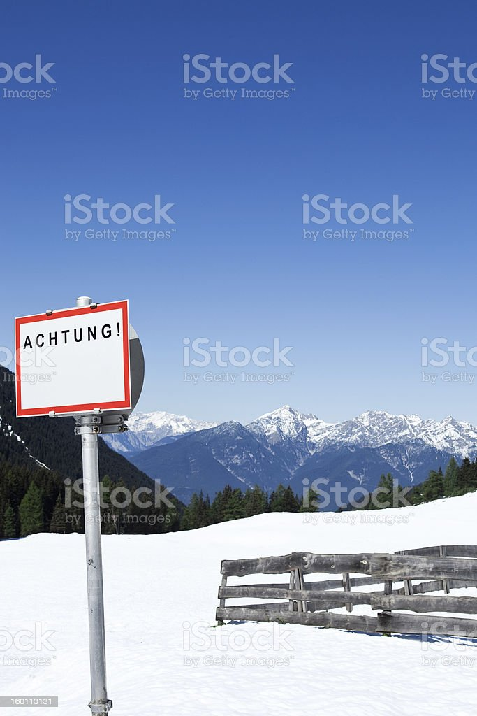 Warning Sign In The Alps stock photo