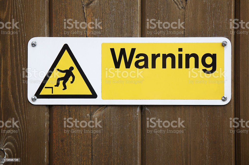 Warning Sign in Yellow with Falling Man royalty-free stock photo