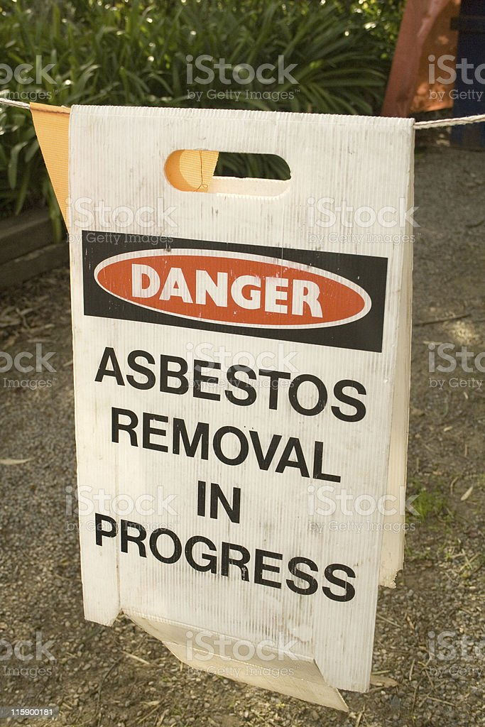 A warning sign of asbestos removal in process stock photo