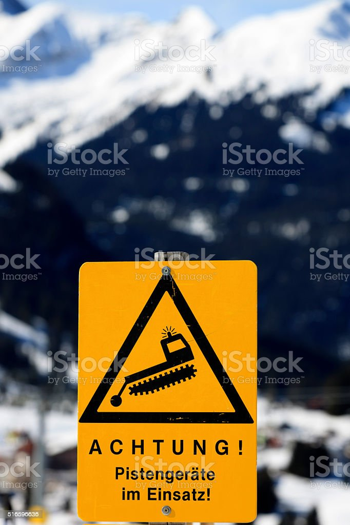 warning sign on a ski slope in the Austrian Alps stock photo