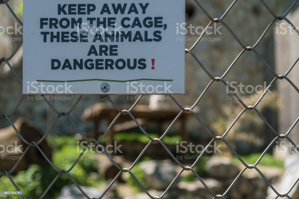 Warning sign on animal cage stock photo
