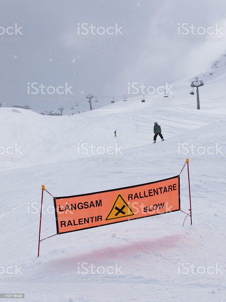 Warning sign on dangerous ski slope royalty-free stock photo
