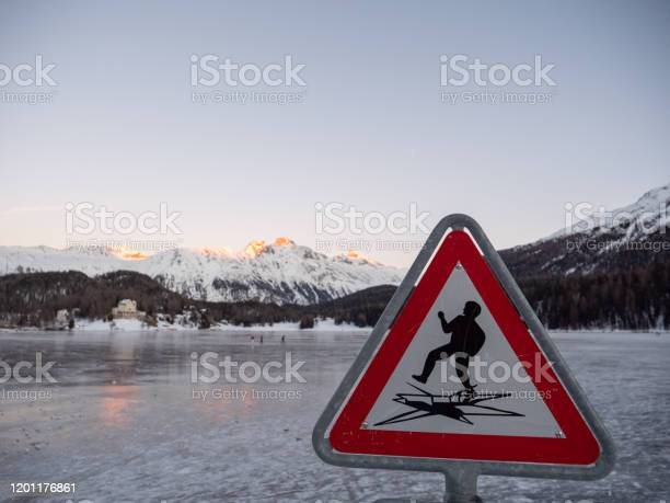 Photo of Warning sign on Frozen lake