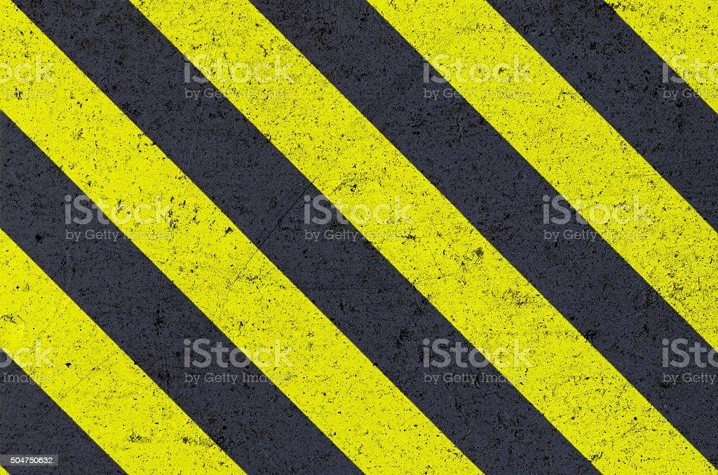 Warning sign on metal texture stock photo