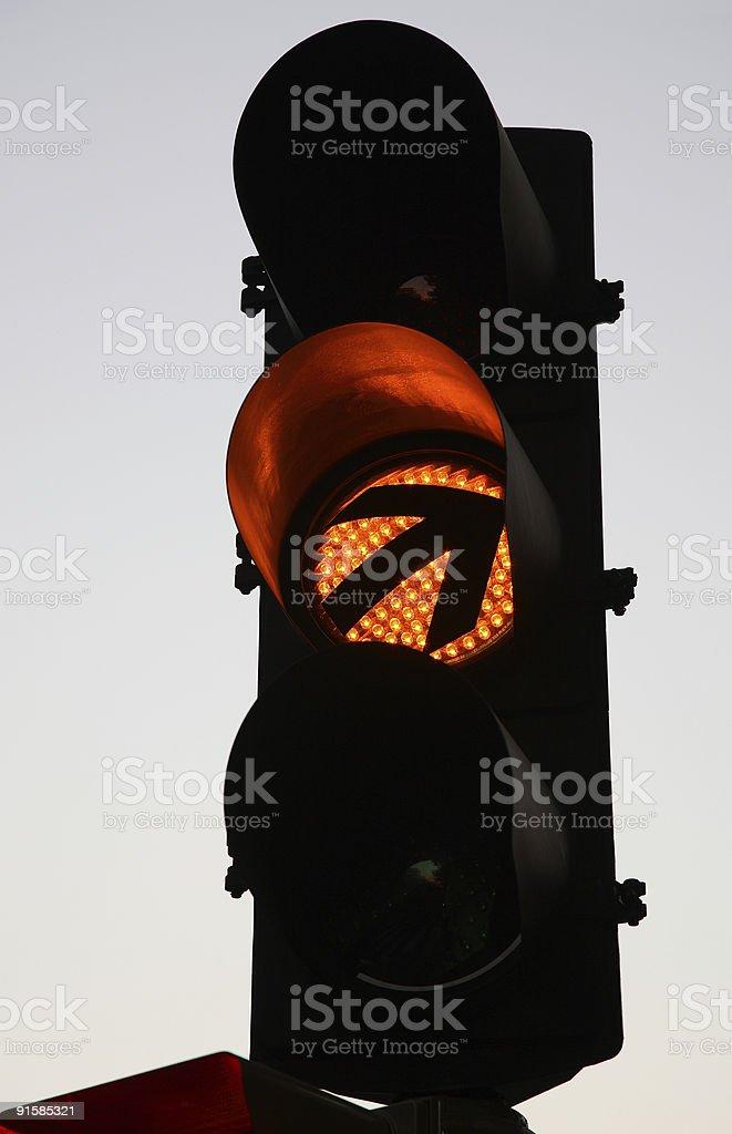 Warning Sign on Traffic Light stock photo