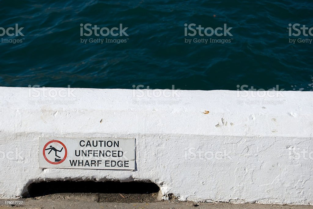 Warning sign on waterfront royalty-free stock photo