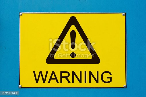 istock Warning sign on yellow metallic board 872001496