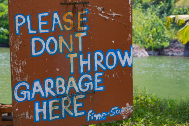 Warning sign Please dont throw garbage fine-50 Warning sign Please dont throw garbage fine-50 on green natural background. Ecology concept. dont throw garbage stock pictures, royalty-free photos & images