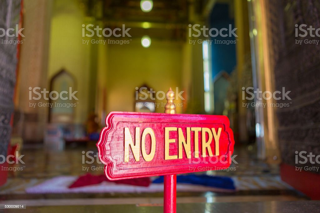 Warning sign post to not enter inside Marble temple, Bangkok stock photo