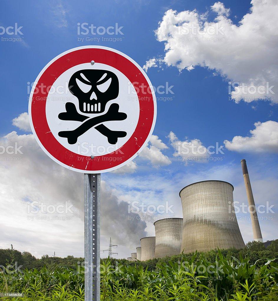 Warning sign radioactivity at cooling tower of power station stock photo