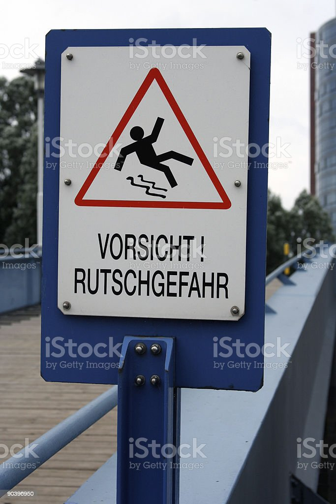 Warning Sign: Slippery Ground royalty-free stock photo