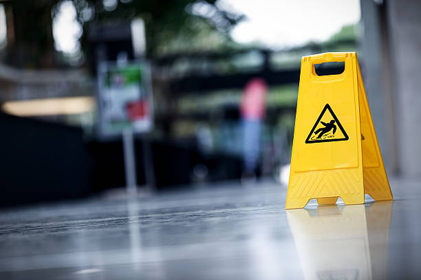 """Warning sign slippery A yellow warning sign """"slippery """" slippery stock pictures, royalty-free photos & images"""
