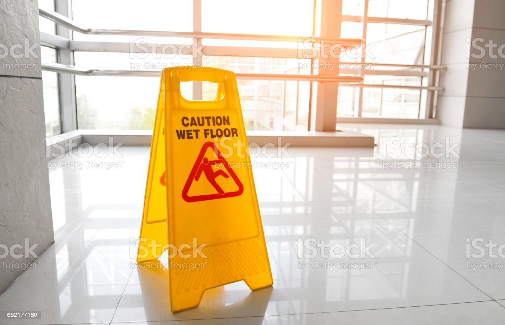 warning sign slippery stock photo