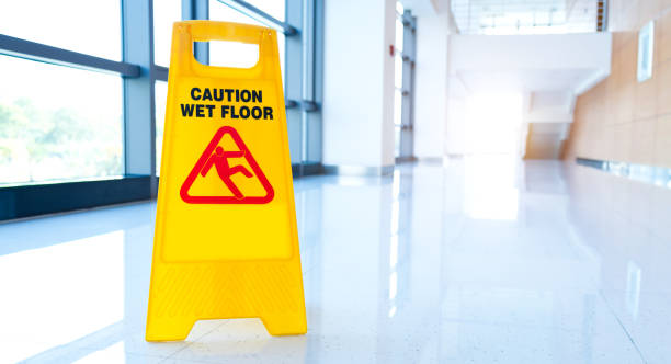 warning sign slippery - fall prevention stock photos and pictures