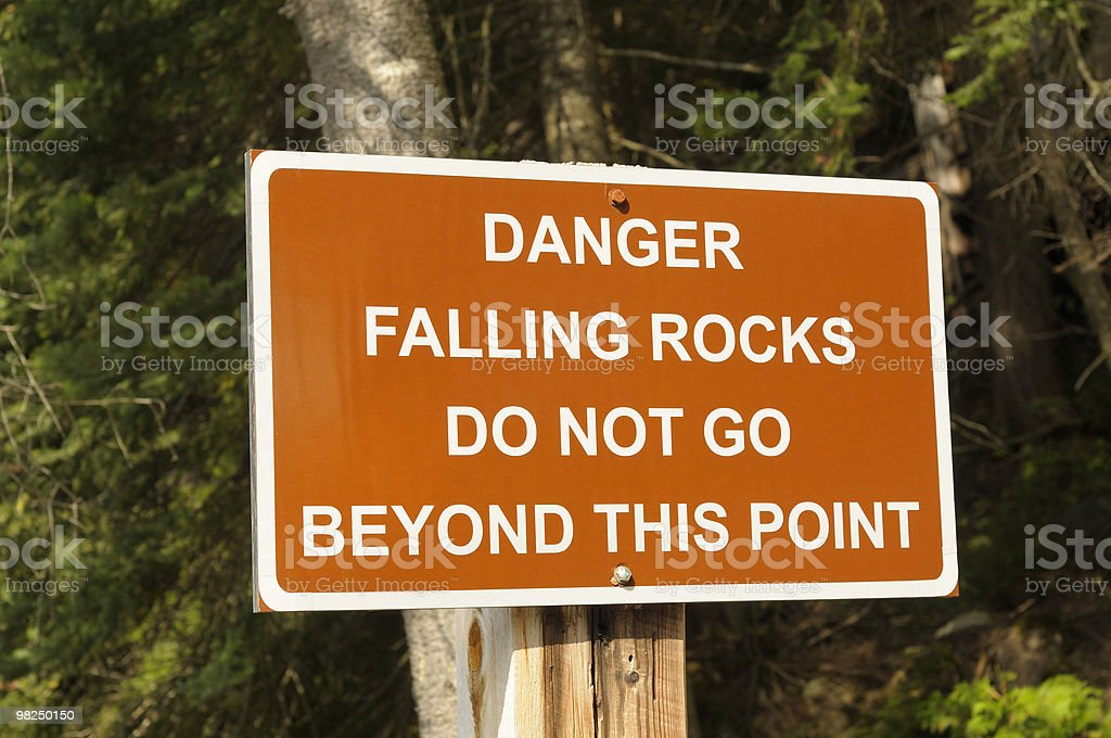 Warning sign stating danger of falling rocks royalty-free stock photo