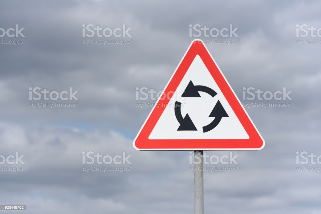Warning sign that soon there will be a road with circular traffic stock photo