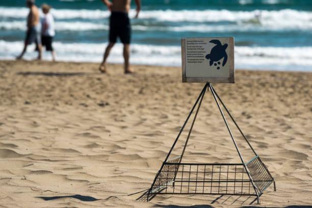 A warning sign to protect sea turtles, Iztuzu beach,Dalyan, Ortaca, Muğla, Turkey stock photo