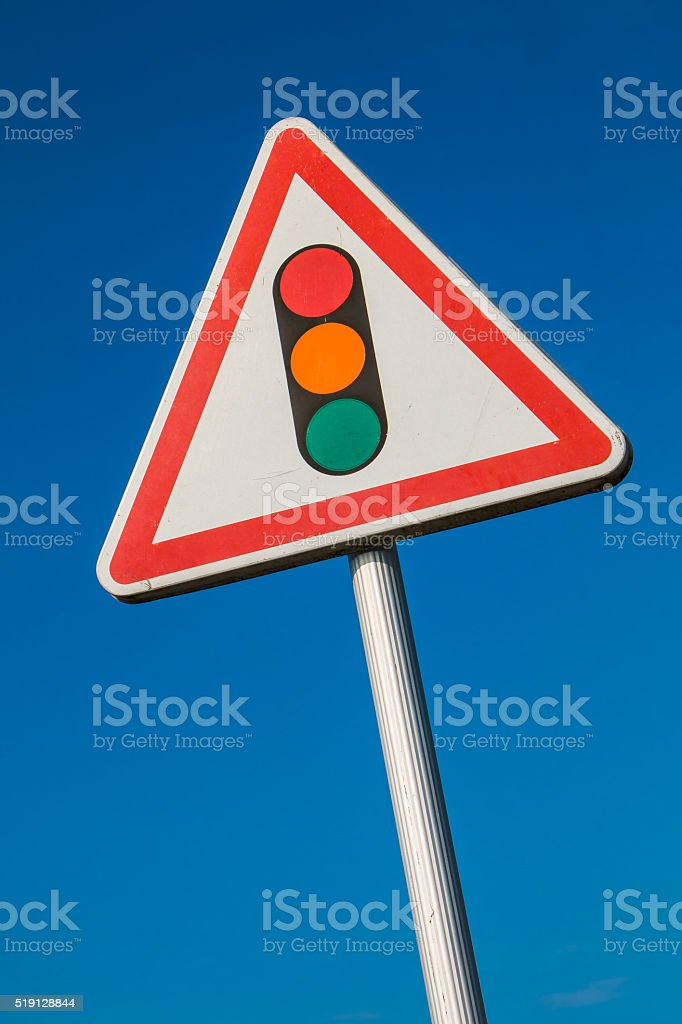 warning sign with a picture of a traffic signal stock photo