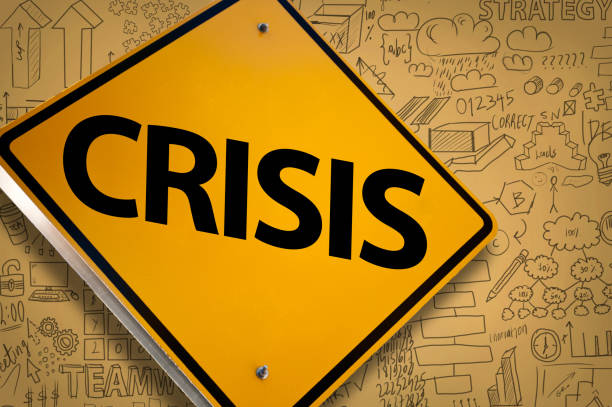 CRISIS / Warning sign -  yellow background concept (Click for more) stock photo