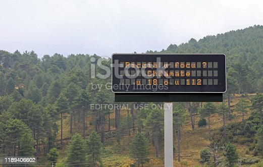 Bastia, Corsica, France - August 23, 2019: warning signal with text that means In case of Fire call 18 or 112 in corsian language