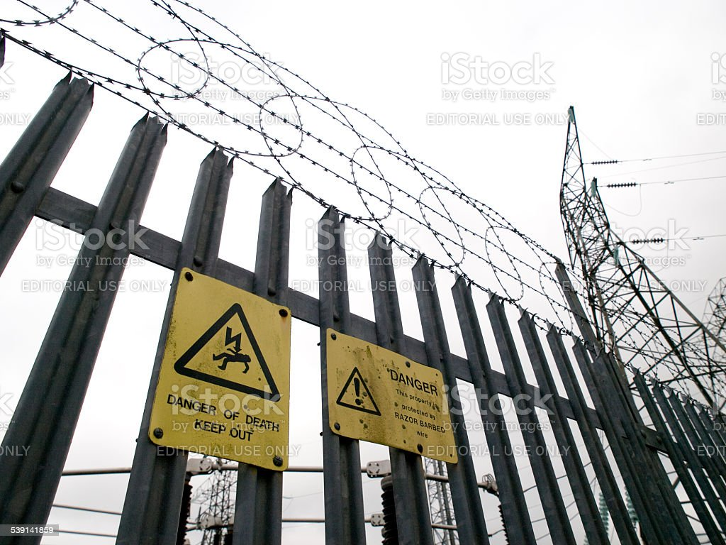 Warning signs on a metal fence stock photo