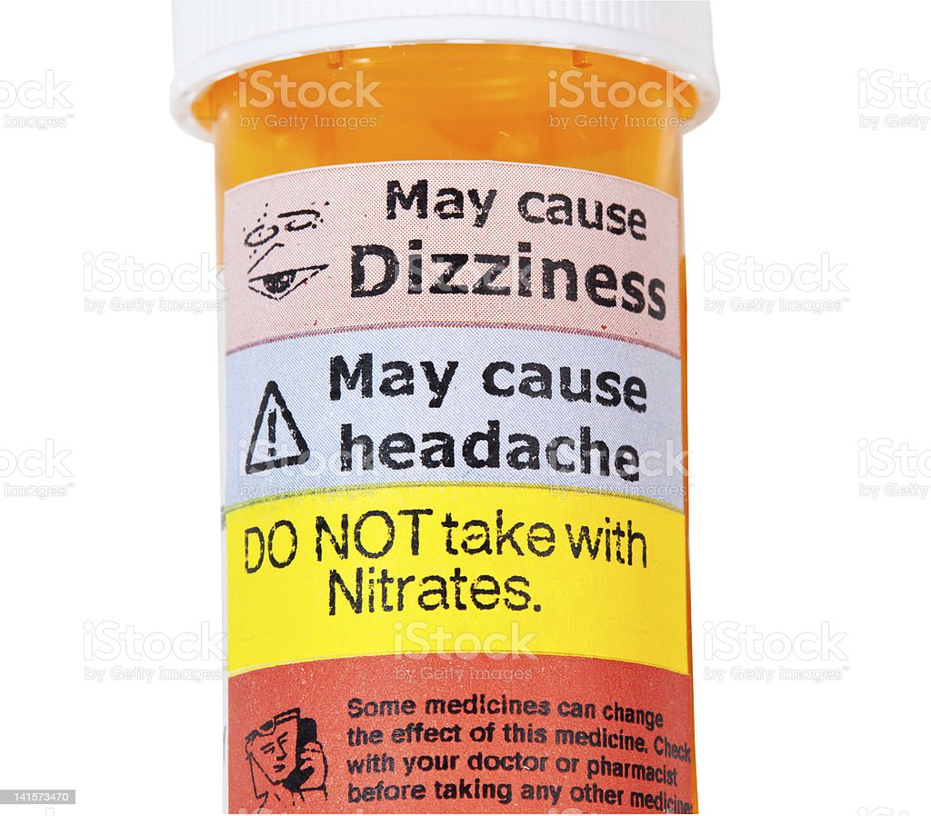 Warning signs on bottle of rx drugs stock photo