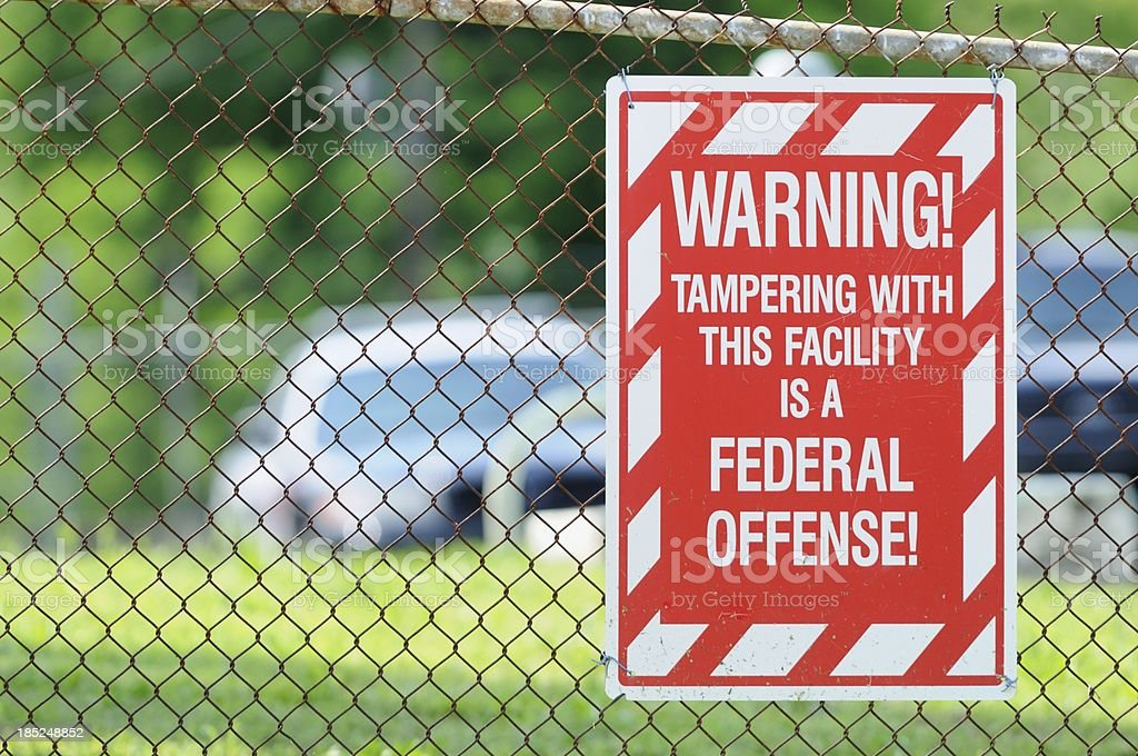 Warning tampering with this facility is a federal offense sign stock photo
