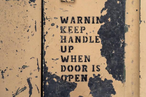 warning text on door macro shot stock photo
