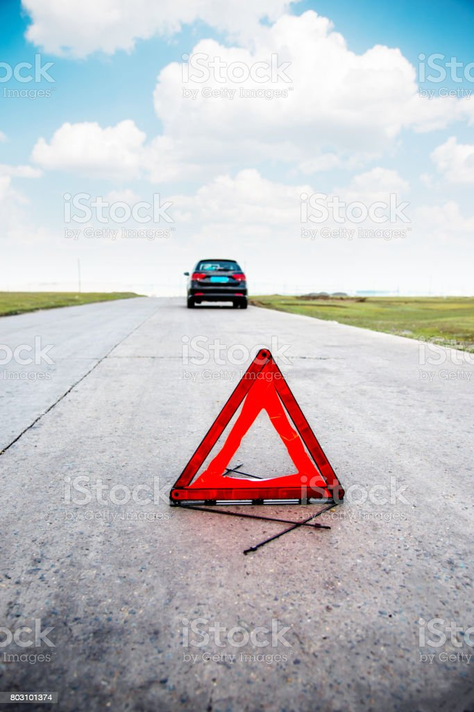 Warning triangle and breakdown car stock photo