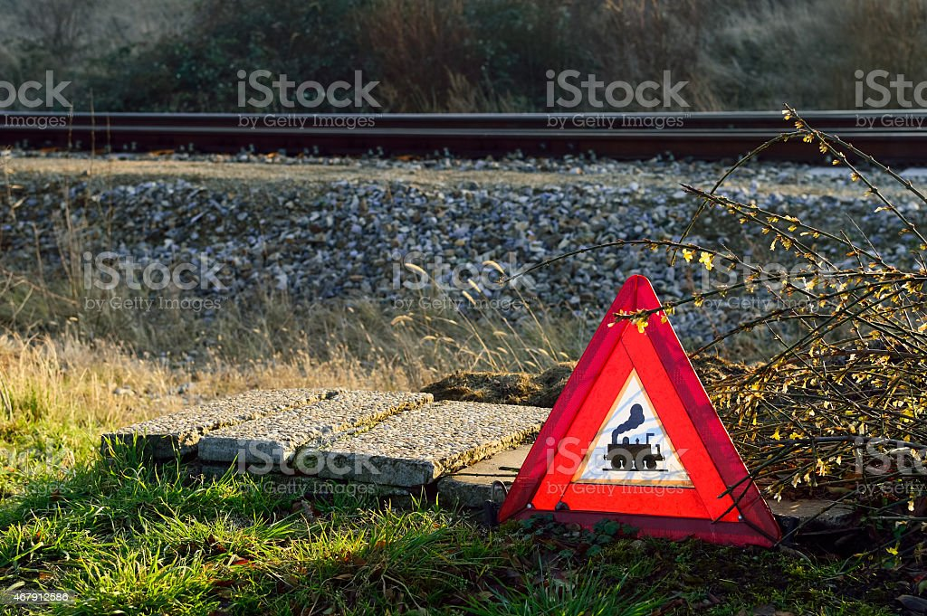 Warning triangle at level crossing stock photo