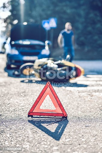 508966965 istock photo Warning Triangle On A Car And Motorcycle Accident Scene 1190889098