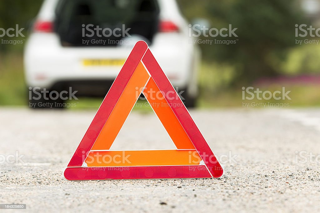 Warning triangle on road used for automobile breakdown royalty-free stock photo