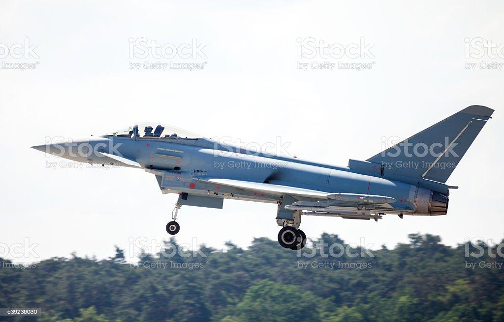 warplane lands on airfield royalty-free stock photo