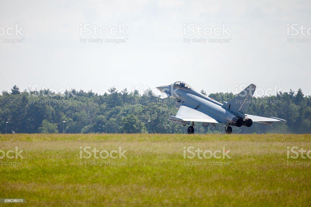 warplane lands on airfield foto de stock libre de derechos