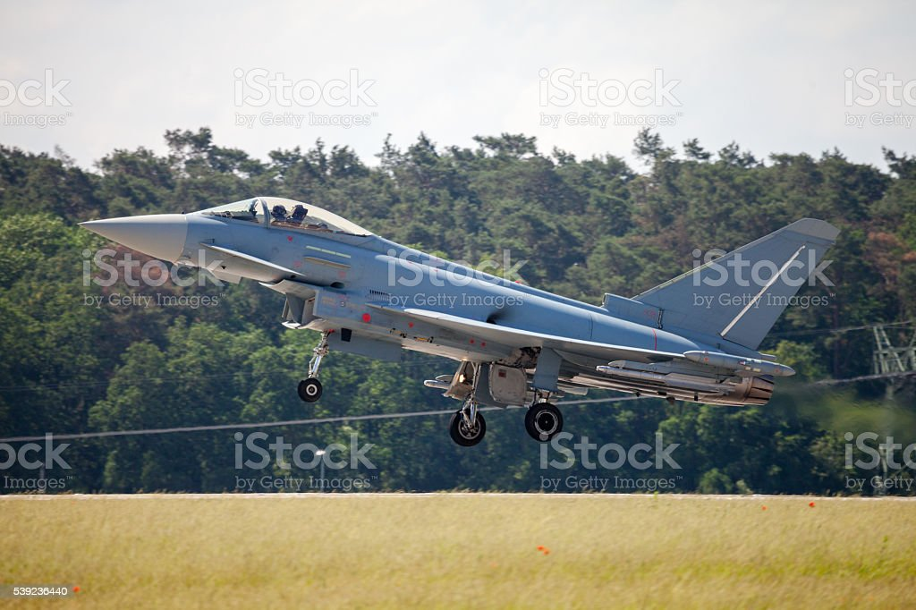 warplane lands on airfield royalty-free stock photo