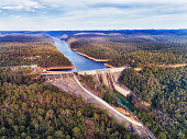 Concrete Warragamba Dam on Warragamba river locking flow of fresh water to form reservoir to supply the Greater Sydney area with drinking water.