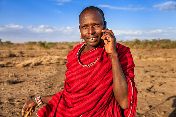 Warrior from Maasai tribe using mobile phone, Kenya, Africa stock photo