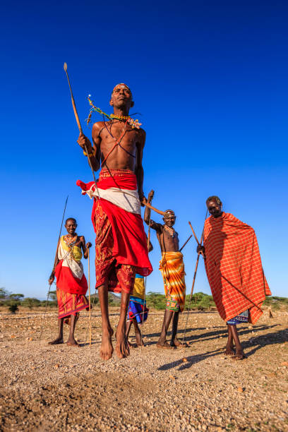 warrior from samburu tribe performing traditional jumping dance, kenya, africa - kenyan culture stock photos and pictures