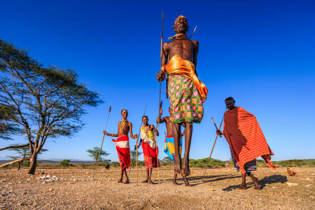 warrior from samburu tribe performing traditional jumping dance, kenya, africa - warrior person stock pictures, royalty-free photos & images